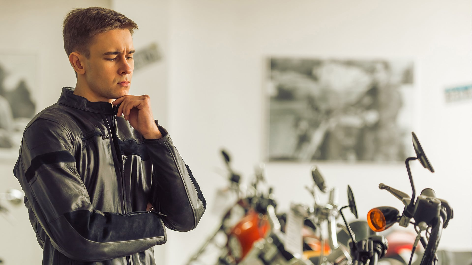 Man thinking and choosing a motorcycle