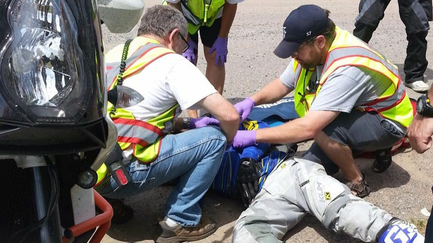 First aiders at motorcycle crash scene