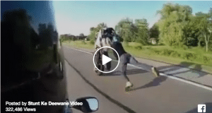 Rider falls off bike while doing a wheelie