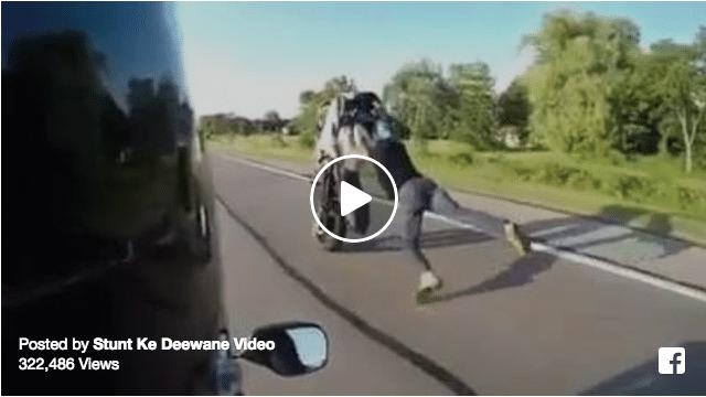 Rider falls off bike while doing a wheelie