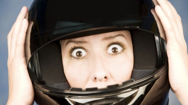Woman in helmet looking worried